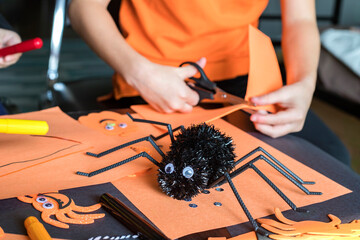 Halloween kids craft preparations. Little children doing  crafts at home. Halloween children party...