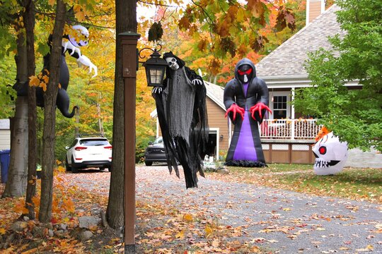 Creepy halloween decors in the yard of a house