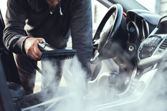 cleaning and disinfecting by steam of the car interior and car seats