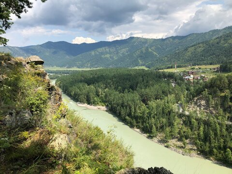 ASKAT, RUSSIA - AUGUST 10, 2019: Mountains, mountain river, trees, top view.