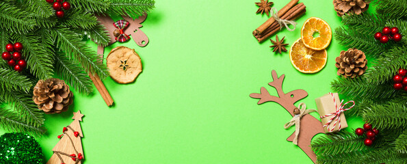 Wall Mural - Top view Banner of Christmas decorations on green background. New Year holiday concept with copy space