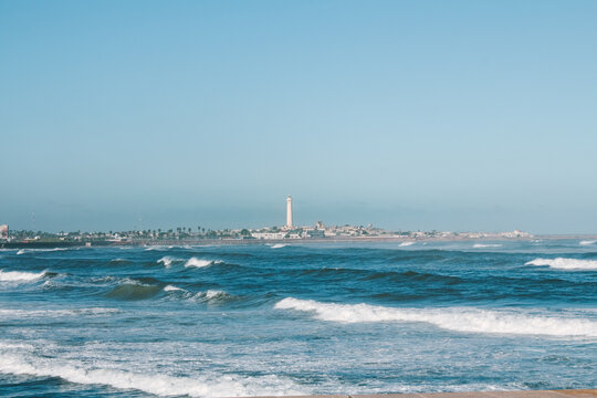 Wavy Atlantic Ocean view with lighthouse in Casablanca, Morocco, North Africa