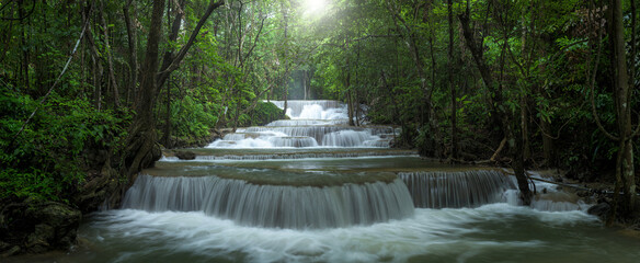 Panoramic beautiful deep forest waterfall in Thailand Wall mural