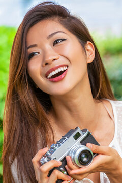 Asian Chinese Woman Girl Taking Photographs With Retro Style Camera
