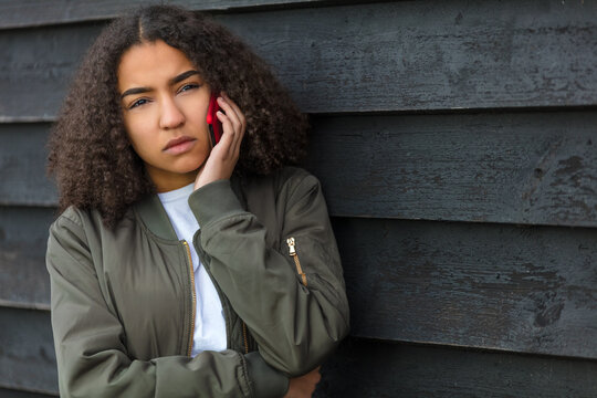 Sad Mixed Race African American Teenager Woman Using Cell Phone