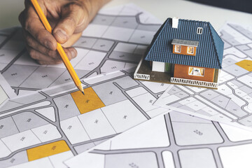 Fototapeta choose a building plot of land for house construction on cadastral map