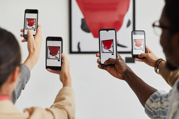 Graphic background of multiple people taking smartphone photos of painting at modern art gallery...
