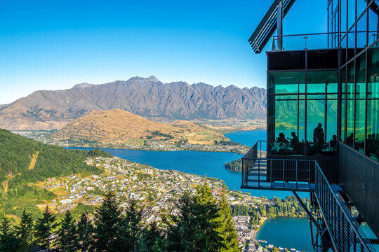 Queenstown, New Zealand - Feb 7, 2020: The tourists are enjoying their meal at Stratosfare Restaurant & Bar on the top of Skyline Gondola.