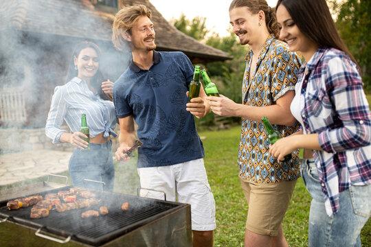 Beautiful young people having fun on a barbecue