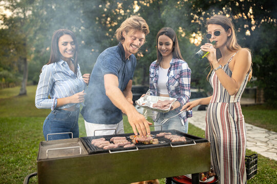 Two couples on a bbq having a good time