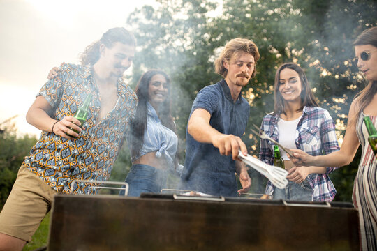 Group of young people having fun with a barbeque