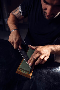 Man sharpening the knife