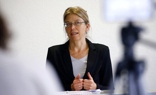 Cantonal physician Christiane Meier addresses the media during a news conference at the center for contact tracing of the Canton of Zurich in Pfaeffikon
