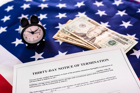 Notice 30 days in advance of termination of the rental contract, on the background of the American flag.
