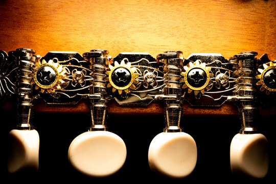 Close Up of Mandolin Tuning System with Ornate Metal and Wood Grain