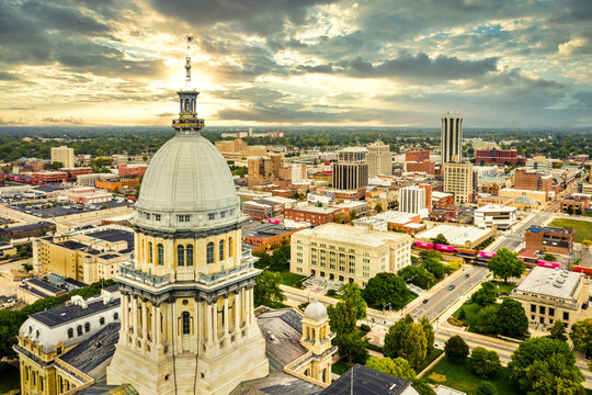 Aerial view of the Illinois State Capitol dome and Springfield skyline under a dramatic sunset. Springfield is the capital of the U.S. state of Illinois and the county seat of Sangamon County
