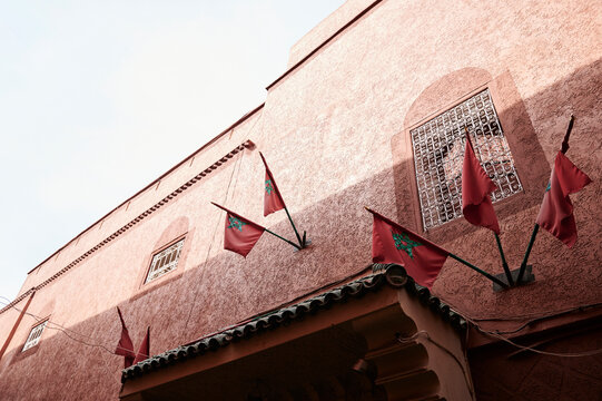 Moroccan facade with national flags