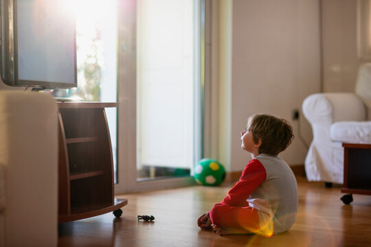 Five year old boy in front of a tv