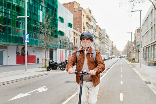 Senior man riding his electric scooter