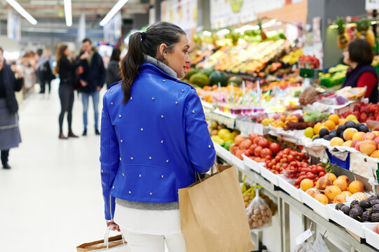 Mature woman grocery shopping