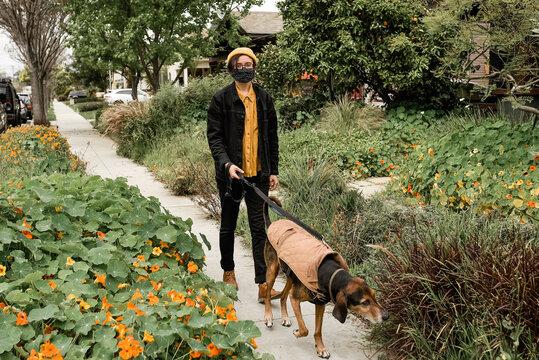Person wearing face mask during Corona Virus walking dog near home