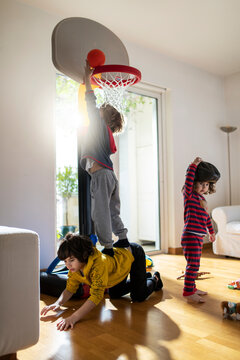 Kids playing basketball indoor