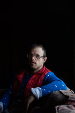 Portrait of middle aged man with Down syndrome