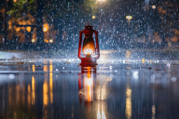old red petrol lamp during the rain reflected in the puddle. autumn background. cold water drops