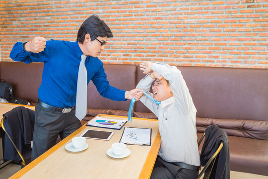 Businessman fighting in office coffee shop