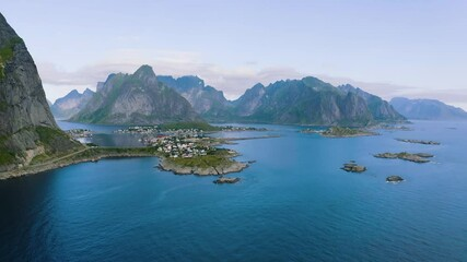 Wall Mural - Flying around Reine fishing village with mountains and fjords on Lofoten islands