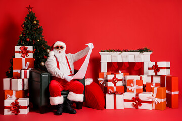 Portrait of his he attractive funky fat amazed stunned Santa sitting in armchair living-room...