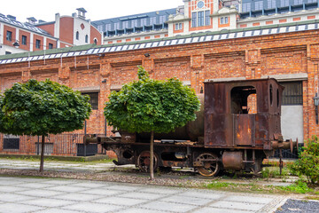 an old rusty spark-free locomotive standing on the promenade in Żyrardów