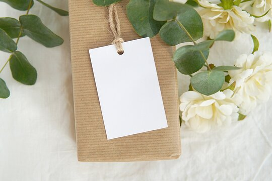 "Thank you gift tag mockup for wedding, bridal shower, rustic wedding favor tag, rectangle 2x3"" label mock up on kraft paper box, eucalyptus branches, white flowers."