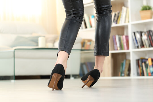 Woman with high heels walking and sprain ankle