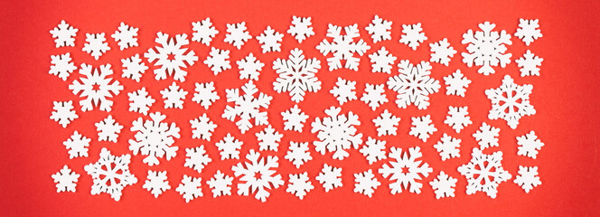 Wall Mural - Top view of white snowflakes on colorful background. Winter weather Banner concept with copy space. Merry Christmas concept