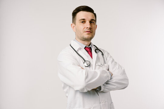 Young man doctor in uniform  posing in studio