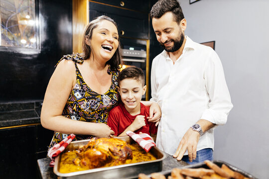 Christmas in Brazil. Brazilian family preparing Christmas dinner in the kitchen.