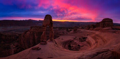 Beautiful panoramic landscape of the unique sandstone rock formation in the desert. Dramatic Colorful Sunset Artistic Render. Taken in Arches National Park, Moab, Utah, United States.