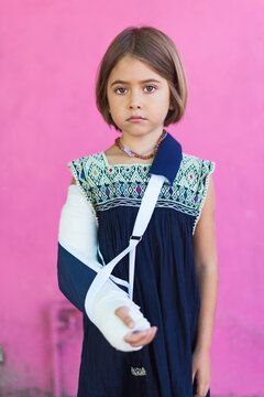 young, sad girl with a plaster cast