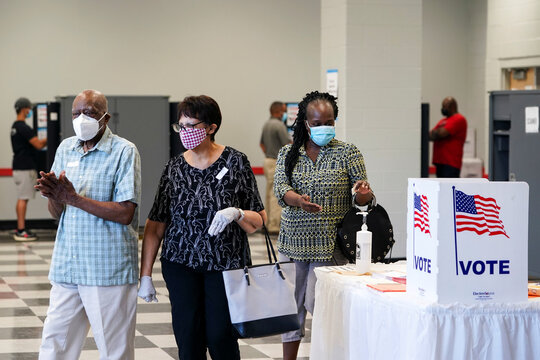 Voters sanitize their hands after casting their election ballots in Atlanta