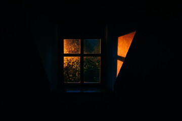 Gold light coming in through a shadowed window. Fotomurales