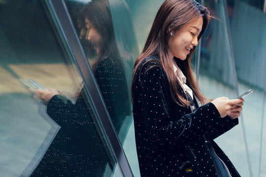 portrait of business woman using a cell phone