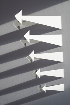 Paper Arrows with Long Shadows