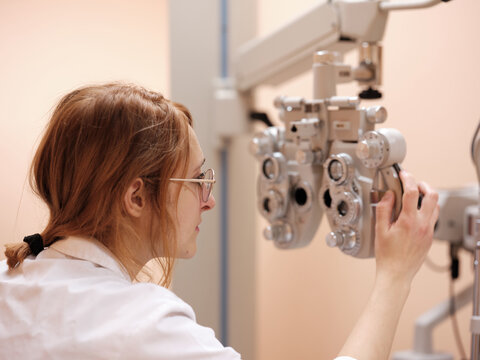 Young optometrist with technical equipment