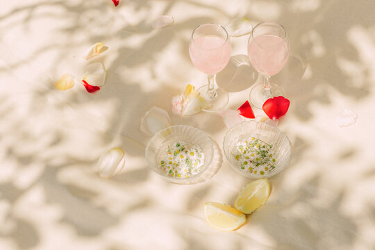 Still life with rose water, chamomile and lemon