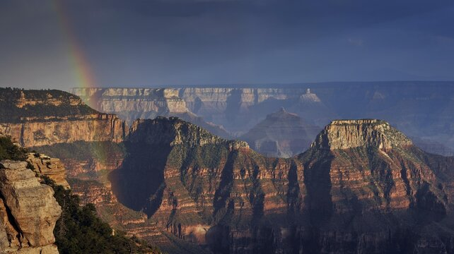 Thunderstorm, rainbow, view from Bright Angel Point with the last light of the day on Wotan's Throne, Walhalla Plateau, Deva Temple, Brahma Temple, evening mood, Grand Canyon National Park, North Rim, Arizona, United States of America, USA, North America