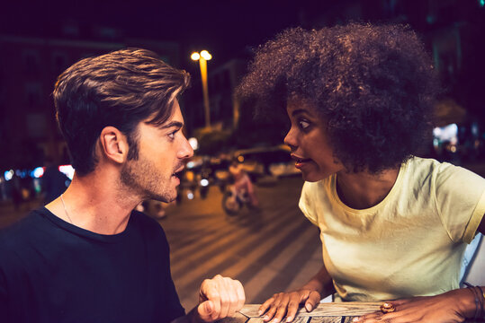 Close-up of angry couple arguing at date night