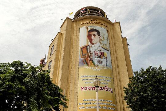 An image of King Maha Vajiralongkorn hangs on the facade of the Deves Insurance Building in Bangkok, Thailand
