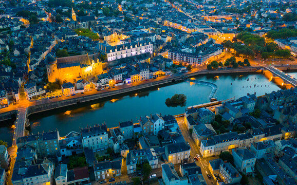 Laval city and Mayenne river in the evening. View from above. France
