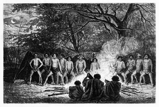 Australian aboriginals dance ritual around fire outdoor in the evening. Ancient grey tone etching style art by Riou and Gusmand, Le Tour du Monde, Paris, 1861